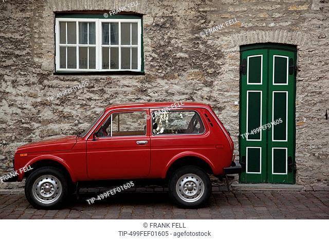 Estonia, Tallinn, Harju, Harjumaa, green door and red car