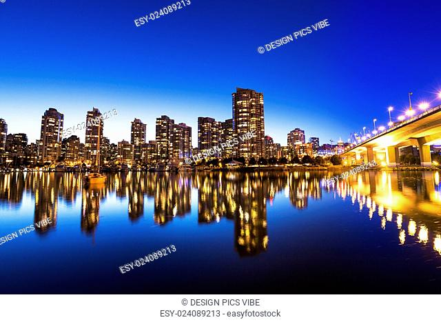 Modern Urban City Skyline Reflecting in Water at Sunset, Vancouver