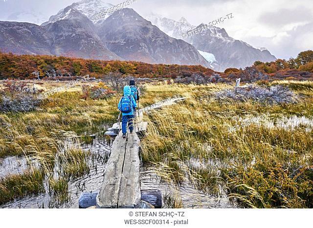 Argentina, Patagonia, El Chalten, two boys hiking towards Fitz Roy in Los Glaciares National park