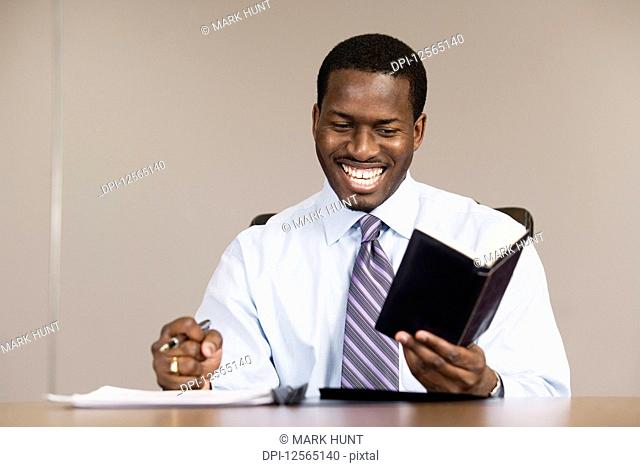 A business man reading in an office