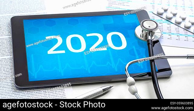 A tablet with the number 2020 on the display