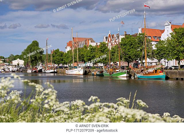 Museums harbour with traditional sailing ships berthed at the Untertrave in the Hanseatic town Lübeck, Schleswig-Holstein, Germany
