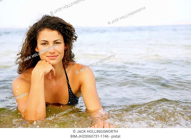 Young woman in water at beach