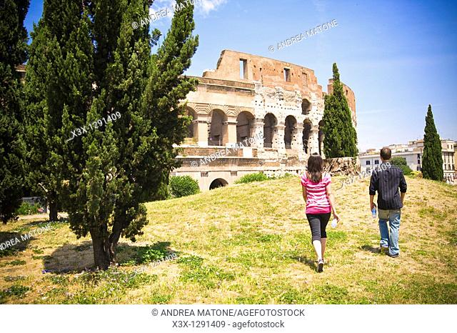 Young couple walking near Colosseum in Rome, Italy