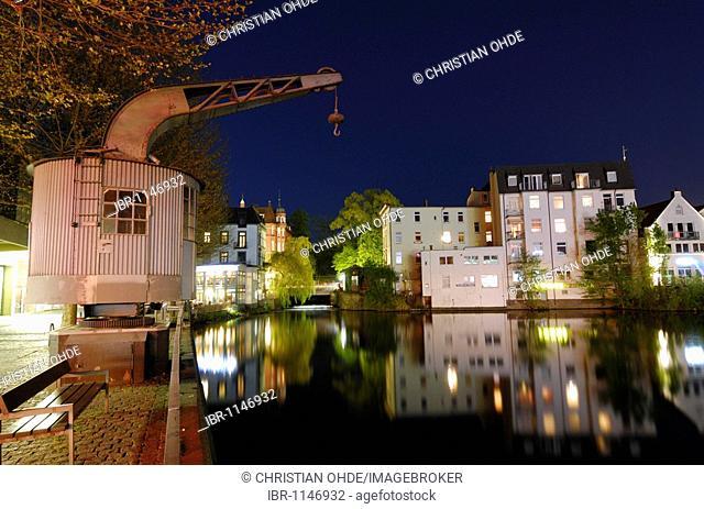 Historical Hafenkran and residential buildings at the Serrahn harbour in Bergedorf, Hamburg, Germany, Europe