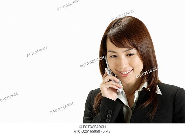 Businesswoman conversing on a cellphone, portrait