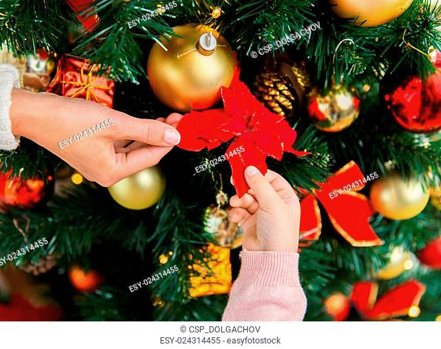 close up of family decorating christmas tree