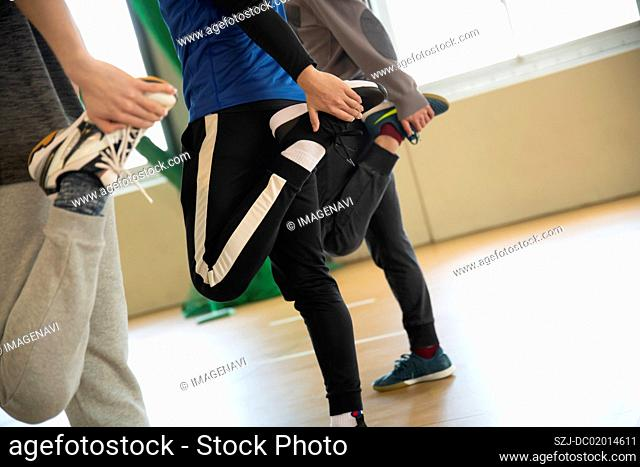 Young people stretching