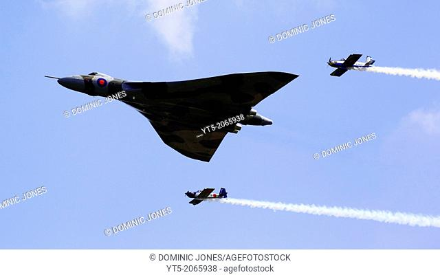 Vulcan XH558 escorted by the RV8ters stunt team the at RAF Cosford Airshow 2012, Shropshire, England, Europe