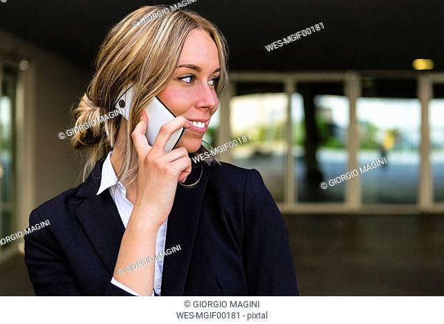 Portrait of smiling businesswoman on the phone