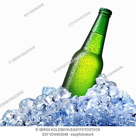 Green beer bottle in ice isolated on white