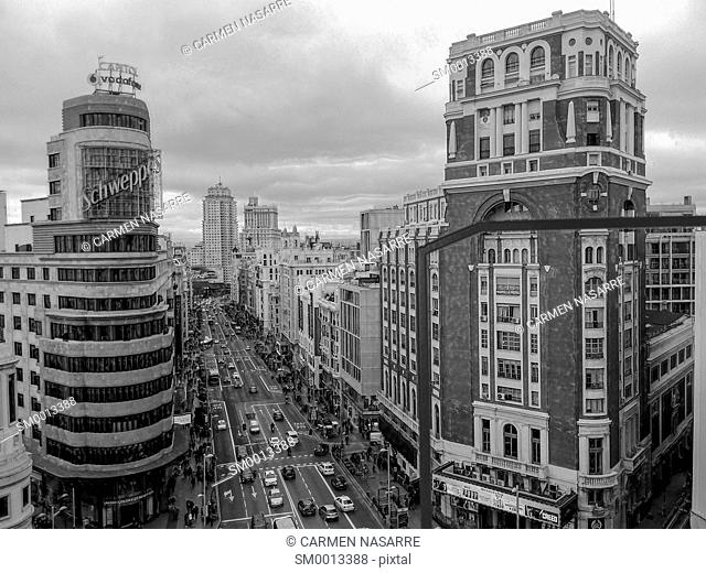 Black and white view of the street Gran Via de Madrid at the height of the Plaza de Callao