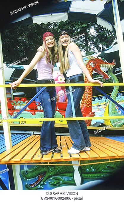 Two Teenage Girls in Amusement Park