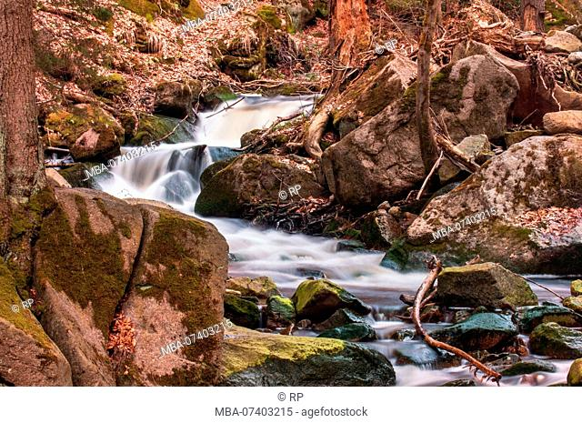 Long exposure mountain river waterfalls at sunset mood light. Ilsefälle of the mountain river Ilse in the Ilsetal in Ilsenburg, National Park Harz