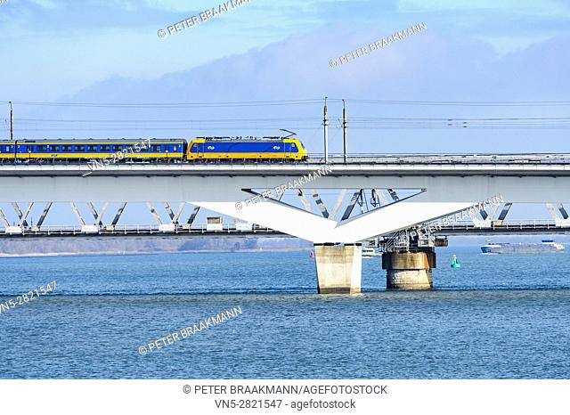 """MOERDIJK, THE NETHERLANDS â. """" JANUARY 29: Train rides on the railway bridge over the Hollands Diep in Holland on January 29, 2017"""