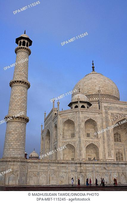 Family at Taj Mahal in pond Seventh Wonders of World on the south bank of Yamuna river , Agra , Uttar Pradesh , India UNESCO World Heritage Site