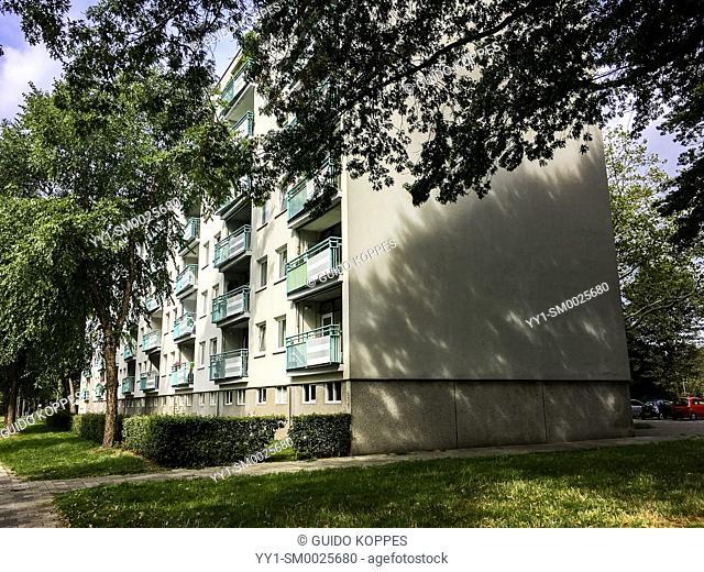 Tilburg, Netherlands. A 1950's build apartment building inside a green suburb neighbourhood