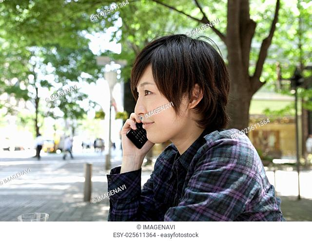 Young woman talking on the mobile phone