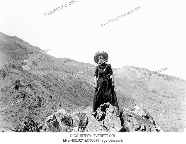 Prospector Mrs. Clara Dunwoody on her variscite mining claim near Sodaville in Mineral County, Nevada. May 1910. Variscite is a semi-precious stone similar to...