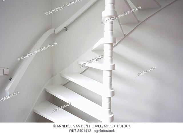 Stairs in modern white room, white wooden stairs with white wall modern