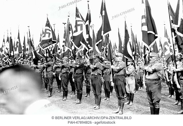 Nuremberg Rally 1933 in Nuremberg, Germany - Line-up of SA (Sturmabteilung) units at the Nazi party rally grounds. (Flaws in quality due to the historic picture...