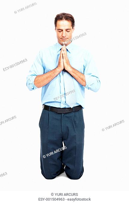 Portrait of mature male executive on his knees praying isolated on white background
