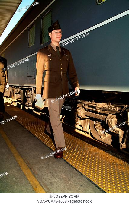1940's reenactor walks along Pearl Harbor Day Troop train reenactment from Los Angeles Union Station to San Diego