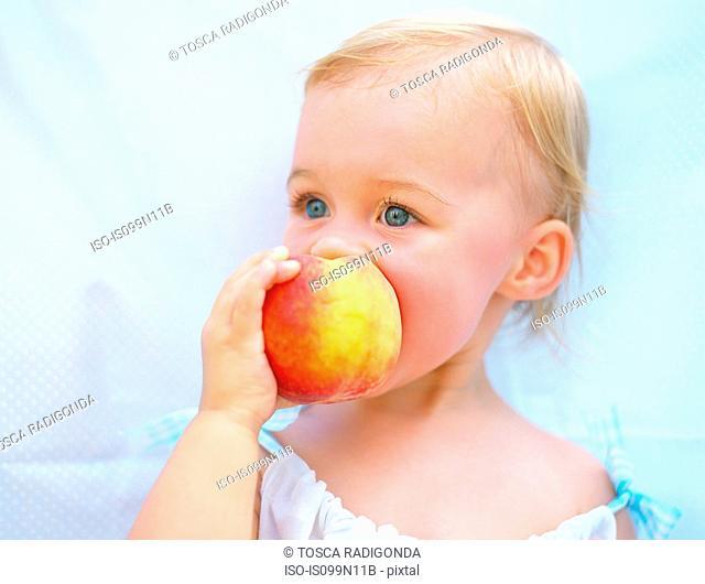 Toddler enjoying peach