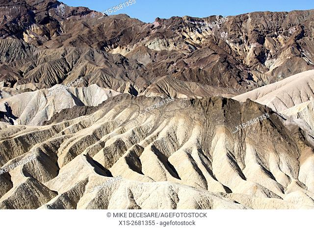 Rock formations around Zabriskie Point in Death Valley seem to flow in sinewy lines from the mountain above, creating gentle curves in a hostile environment