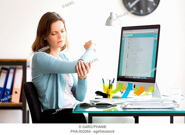 Woman at work suffering from elbow pain