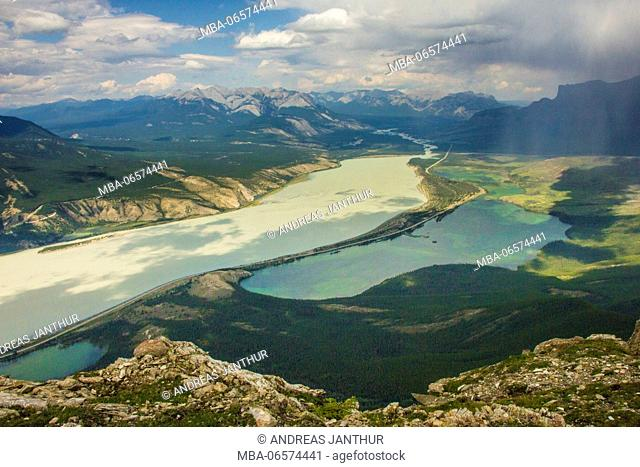 Canada, Rocky Mountains, lakes and rivers in the valley, light and shadow play through the clouds