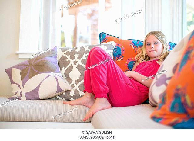 Portrait of girl reclining on sofa