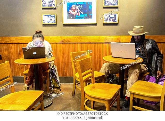New York City, NY, People Using Free Wifi Connection inside Starbuck's Coffee Shop in the East Village, Manhattan