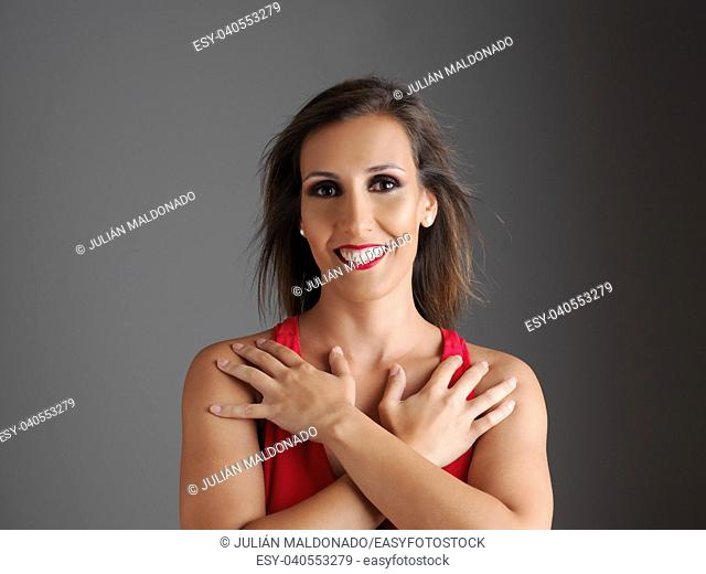 Young and pretty woman with red dress