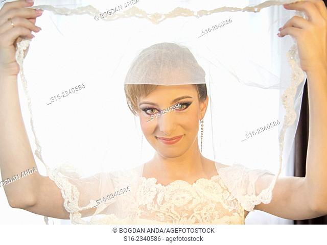 Beautiful young bride holding her veil - Bucharest, Romania, Eastern Europe, Europe