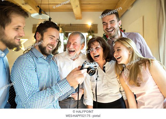 Laughing family looking at camera