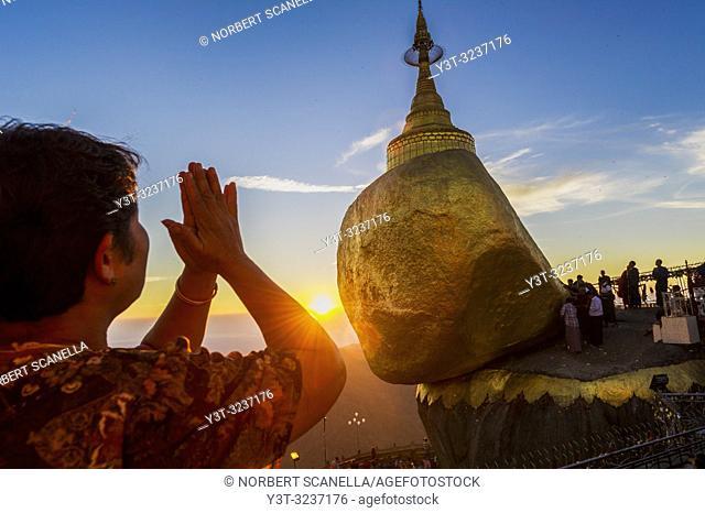 Myanmar (formerly Burma). Kyaiktiyo. State Mon. Sacred site of the golden rock. Pilgrim woman praying