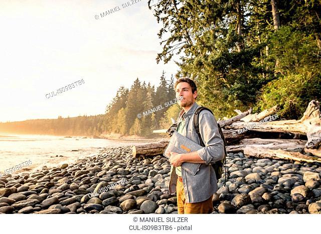 Man gazing from beach in Juan de Fuca Provincial Park, Vancouver Island, British Columbia, Canada