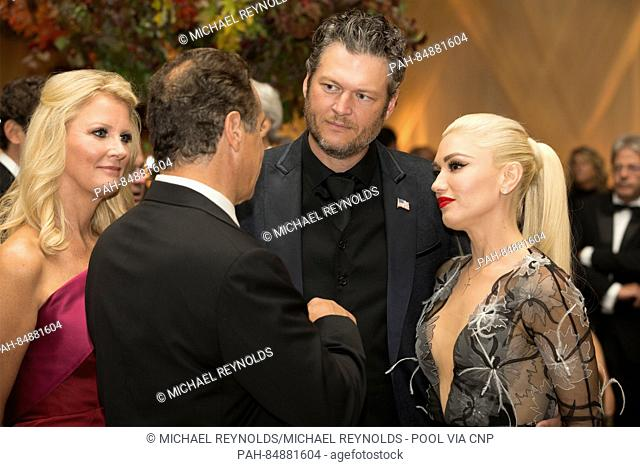 US entertainer Gwen Stefani (R), US entertainer Blake Shelton (2-R), New York Governor Andrew Cuomo (2-L) and US chef and author Sandra Lee (L) attend a state...