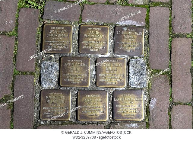 Netherlands, Gouda, 2017, Stumbling stones, or stolpersteine are memorial brass plates placed into the pavement outside certain houses or deportation zones in...
