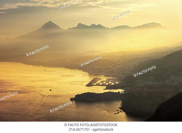 Mascarat area and Sierra de Bernia y Ferrer by sunset at the Mediterranean sea. Altea. Alicante. Valencia Community. Spain
