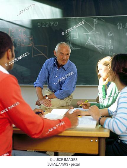 Teacher instructing students in class