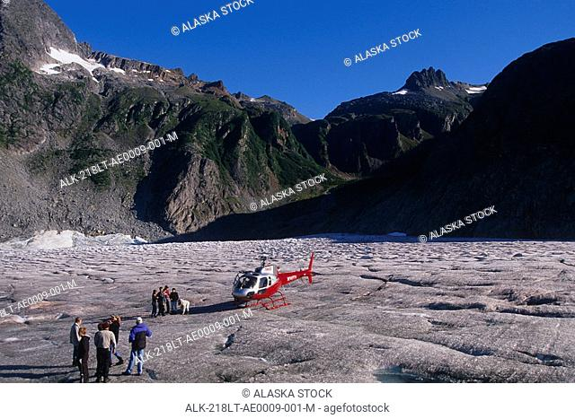 People on walking tour on top of Mendenhall Glacier Southeast Alaska Summer Tongass National Forest
