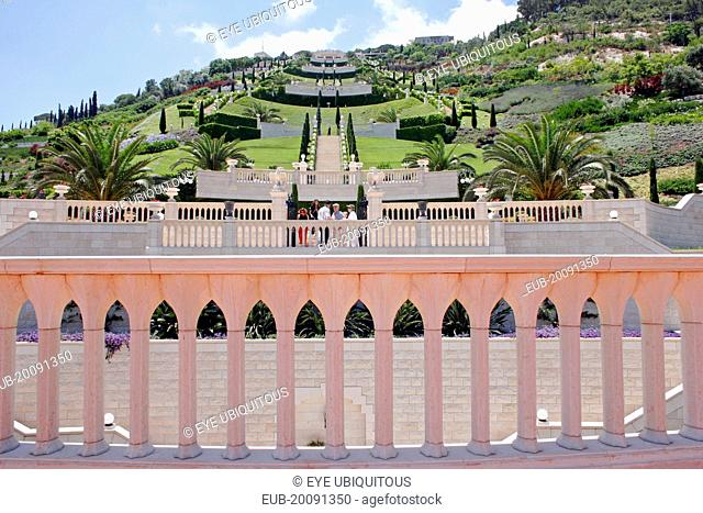 Zionism Avenue. View of Baha'i gardens built as memorial to founders of the Baha'i faith. Colonnaded balcony in foreground with view across tiered gardens...
