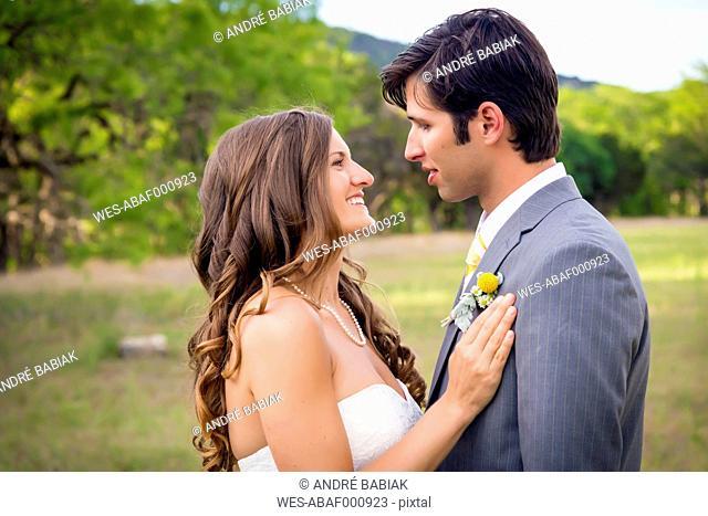 USA, Texas, Bride and groom at wedding ceremony