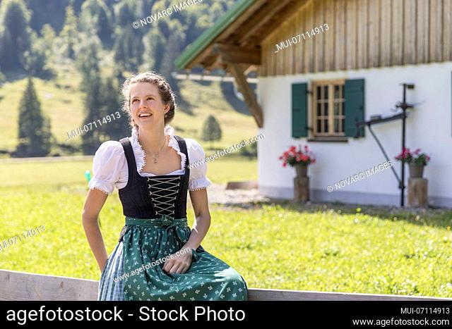 Portrait of a young peasant woman with dirndl
