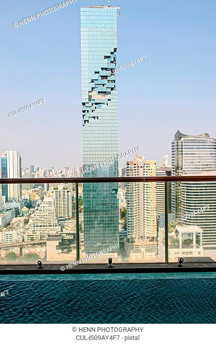 View of skyscraper from swimming pool at luxury apartment, Sathorn, Bangkok, Thailand