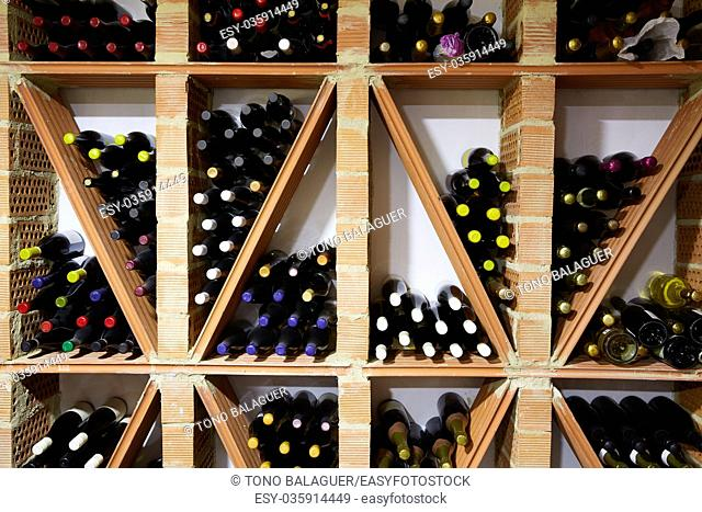 Wine Cellar from Mediterranean with bottles stacked in rows