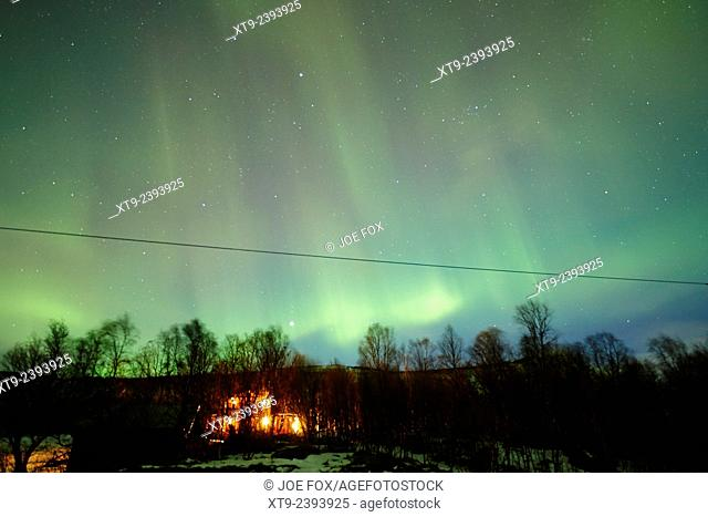 rural house with full sky canopy of northern lights aurora borealis near tromso in northern norway europe