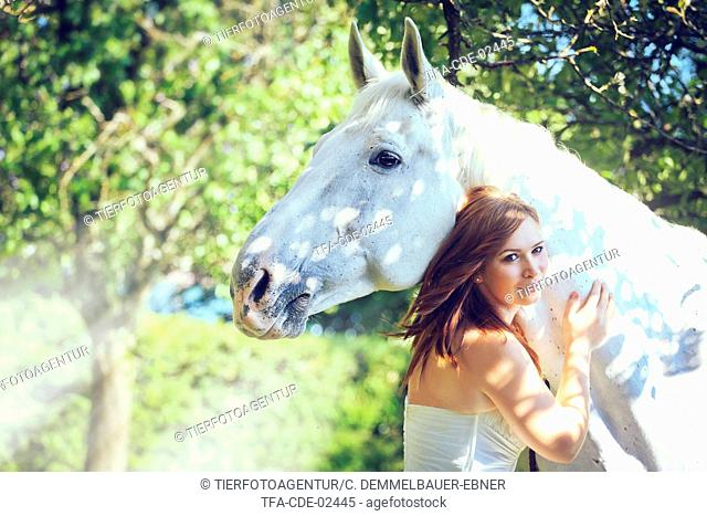 woman and white horse